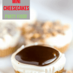 Pinterest image of one no bake cheesecake bite from mini muffin tin with chocolate sauce on top