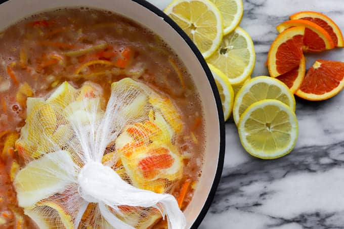 Making blood orange marmalade on day one with fruit, peel, seeds and pith soak