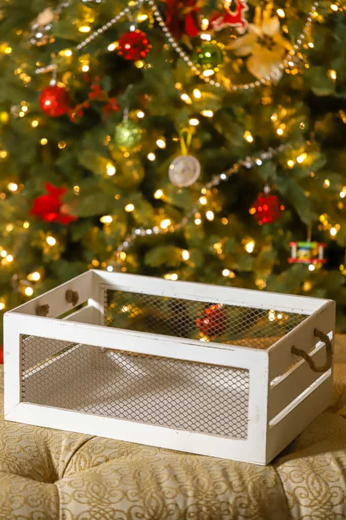 empty white container for gift basket by christmas tree
