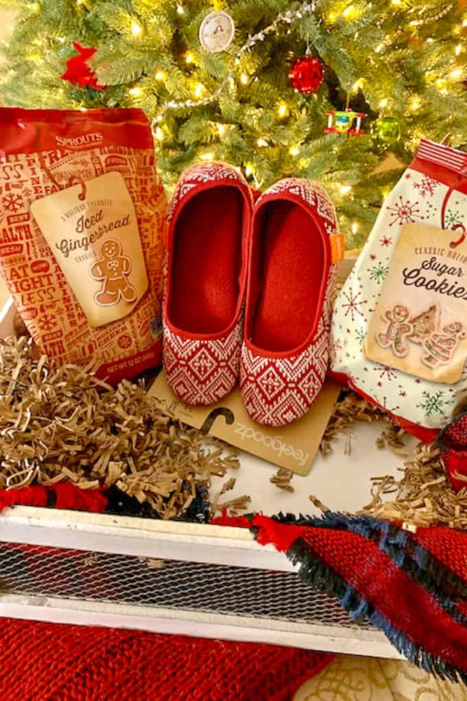 cookies and slippers in a container for gift basket