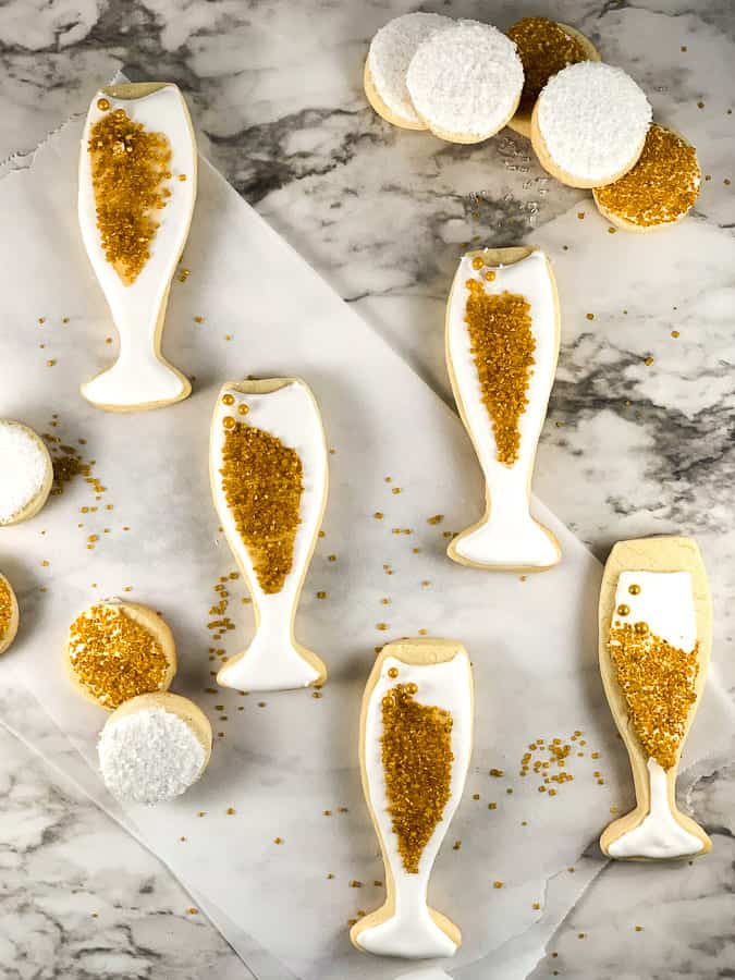 New Years Eve cookies in gold and white royal icing