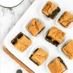 Green border around image of cut squares of chocolate peanut butter fudge