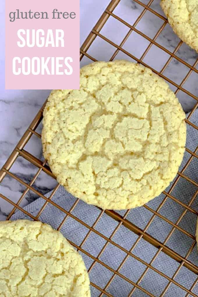 Almond flour sugar cookies are nod to the classic sugar cookie but are made with ingredients that are gluten free. These round, thin cookies are formed from balls of cookie dough that are rolled in sugar before baking. The result is a homemade treat with a crunchy outside and slightly chewy inside. #glutenfree #sugarcookies #almondflourrecipe #glutenfreecookies #abakershouse