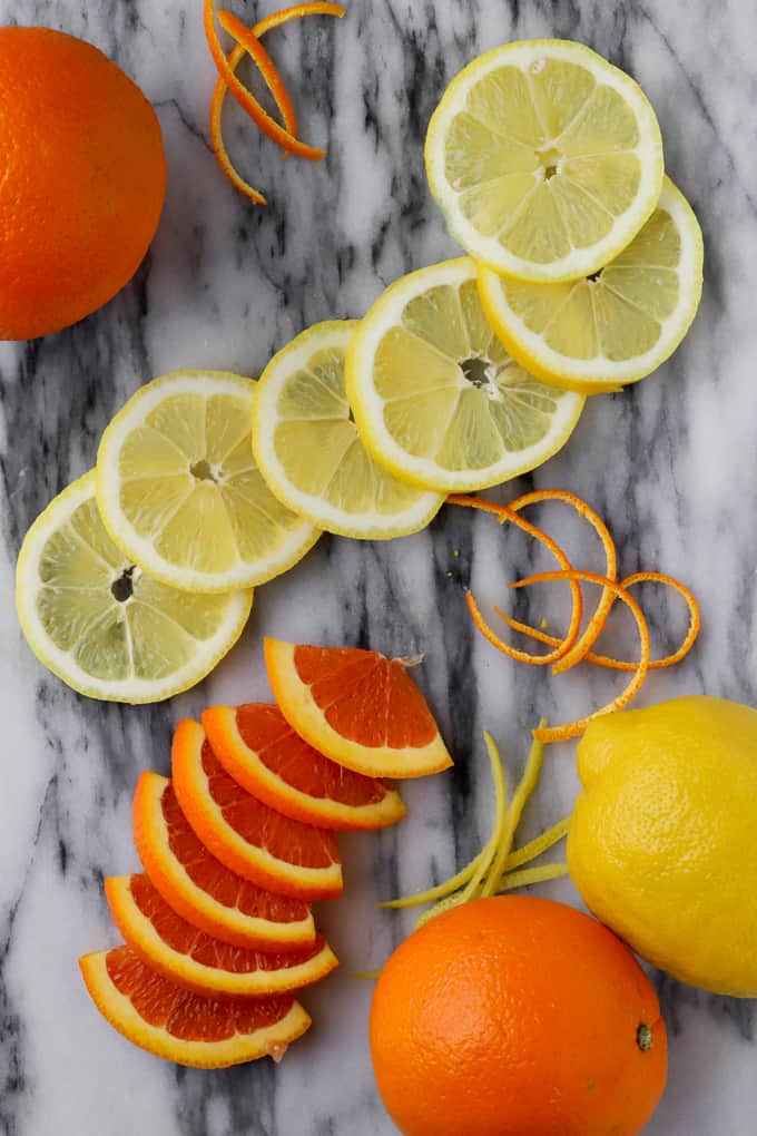 slices of lemons and cara cara oranges on a marble board