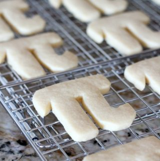 Happy Pi Day with greek letter pi day cookies on a wire cooling rack