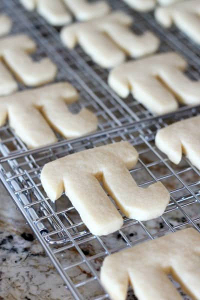 pi shaped cookies on baking cooling rack