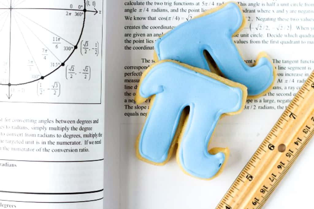 pi cookie on a book with a ruler