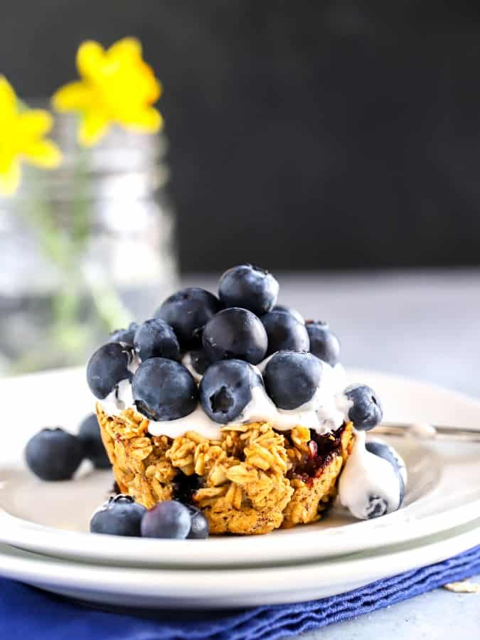 Blueberry baked oatmeal cup with cocowhip topping and blueberries for dessert