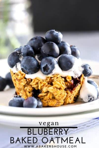 Mounds of blueberries atop a baked blueberry oatmeal cup with cocowhip topping for dessert