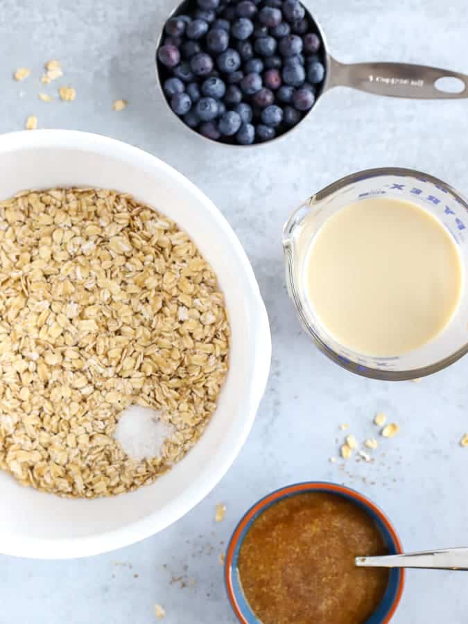 Ingredients of oats, blueberries and oatmilk for bluerberry oatmeal cups