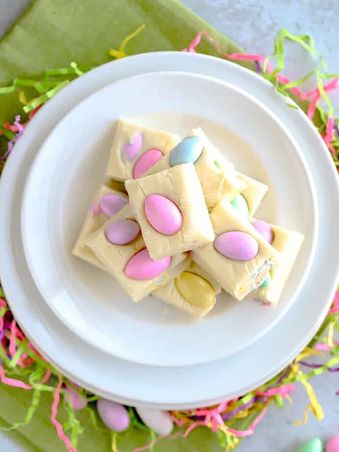 Easter white chocolate fudge stacked on a white plate