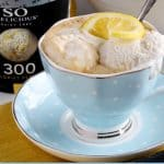 Pinterest image for tea affogato in blue and white tea cup with lemon slice