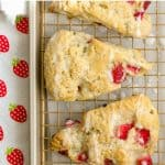 Overhead photo of three strawberry scones with glaze