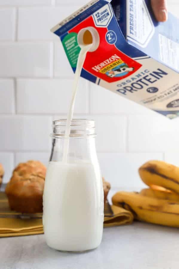 Horizon organic milk poured into milk glass