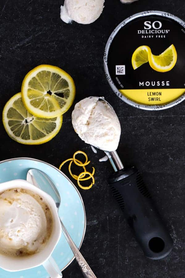 Overhead photo on black background of So Delicious Lemon Swirl Mousse and tea affogato