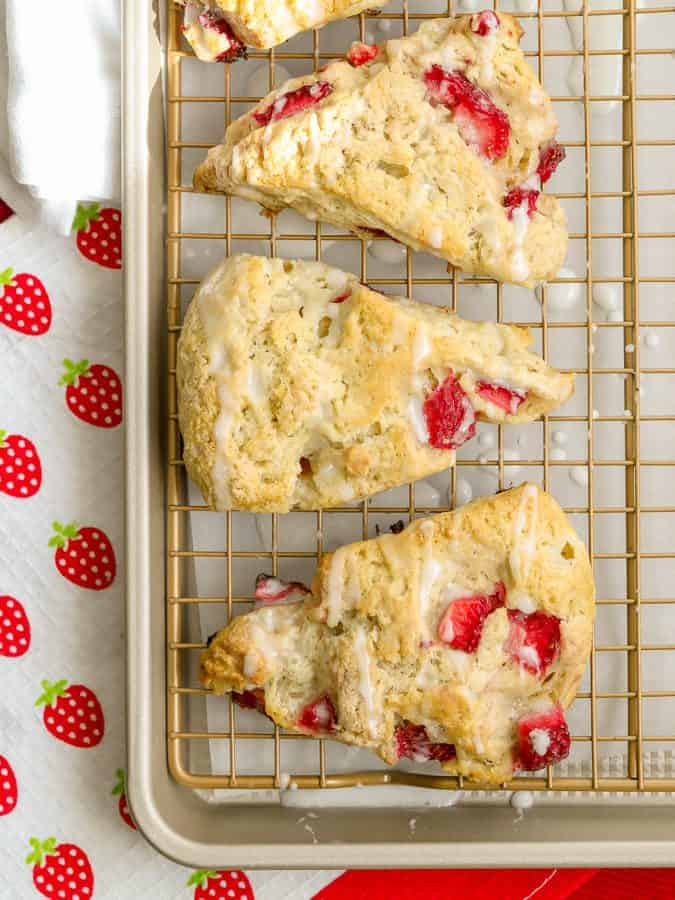 Homemade strawberry scones with powdered sugar glaze
