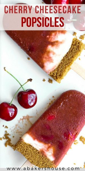 Pinterest image of two cherry cheesecake popsicles with cherries on a white plate