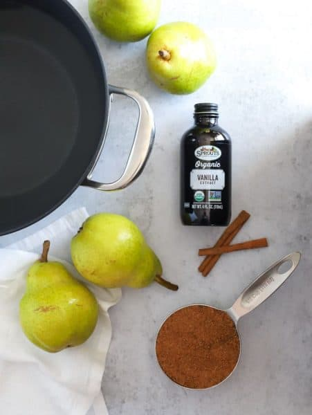 Ingredients to poach pears with vanilla and cinnamon