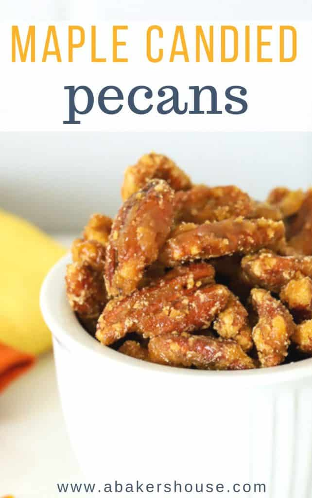 Close up photo of candied pecans with maple syrup in a white bowl for Pinterest sharing