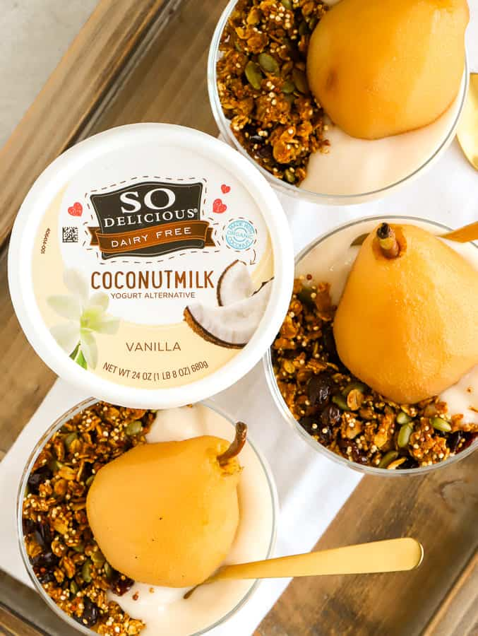 overhead photo of coconutmilk yogurt alternative and pears with granola