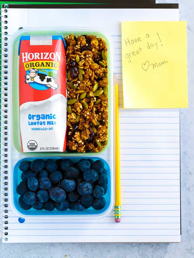 Notebook with lunch box of pumpkin granola and horizon organic milk