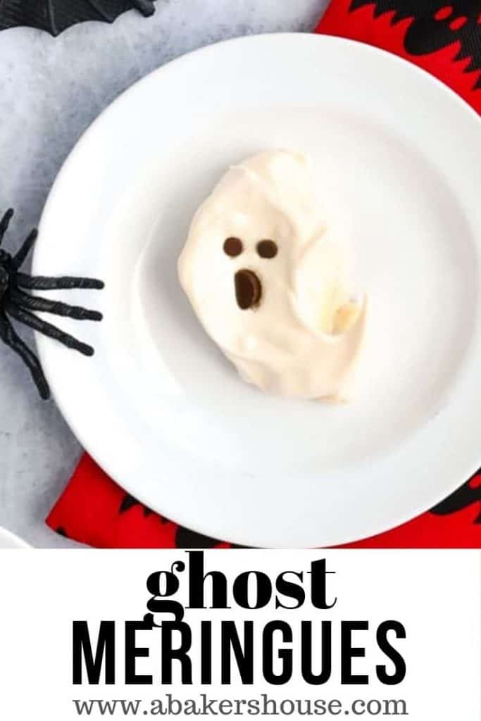 Pinterest image of one ghost meringue cookie on white plate