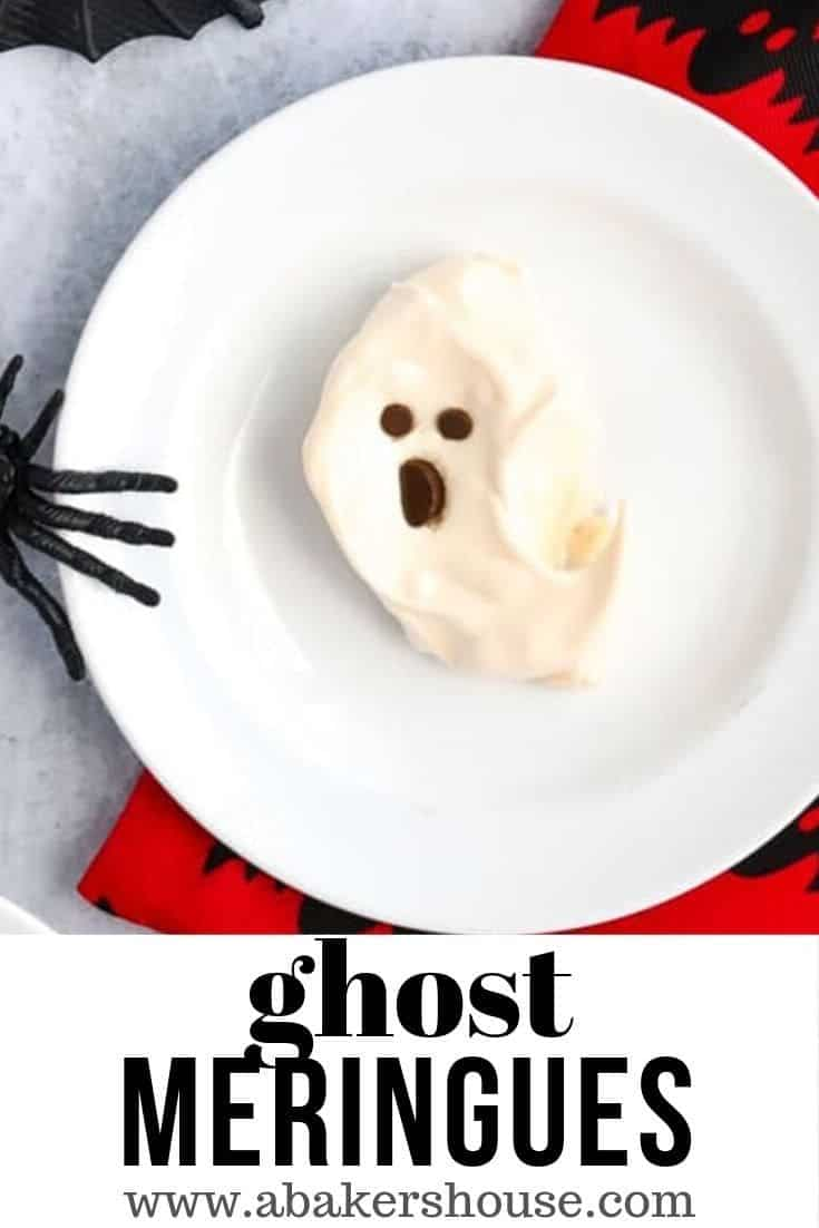 Ghost meringues are a perfect dessert for a Halloween party: easy to bake ahead of time and the recipe makes plenty for a crowd. Turn meringues into ghosts with a few pieces of chocolate. You'll have fun with these spooky ghost meringues dripping in a scary strawberry sauce. #abakershouse #Halloween #ghostcookies #ghostmeringues #meringues #meringuecookies #ghos #dessert #Halloweendessert #spooky