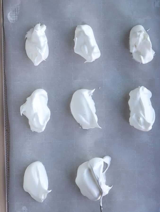 oval meringues on baking tray