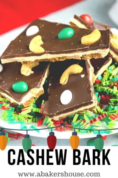 Pinterest image of a stack of cashew chocolate bark on white plate
