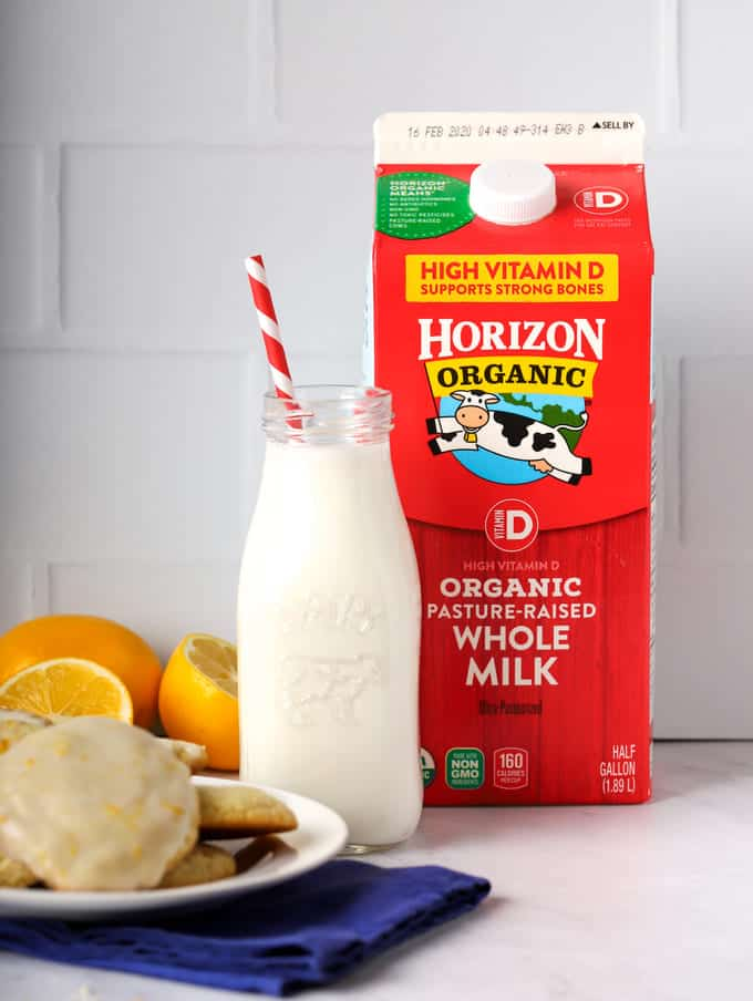 horizon organic milk carton with bottle of milk and red straw and plate of cookies