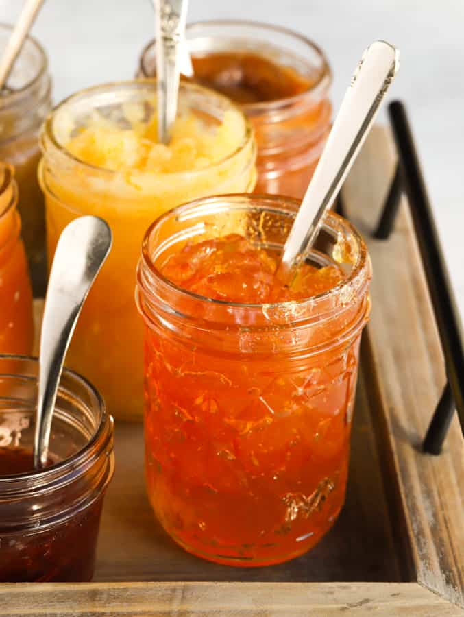 Jars of orange marmalade and other jams made at high altitude