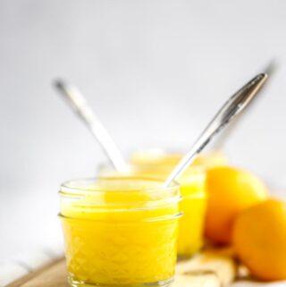 Two jars of lemon curd and meyer lemons