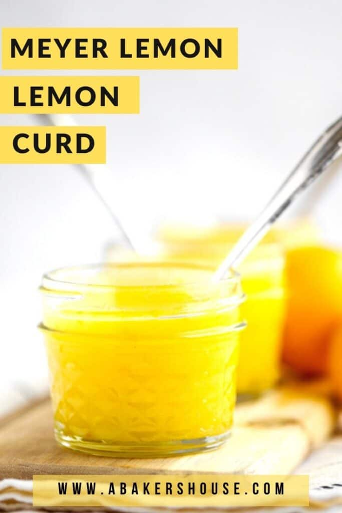 Jars of meyer lemon curd with spoons on wooden cutting board