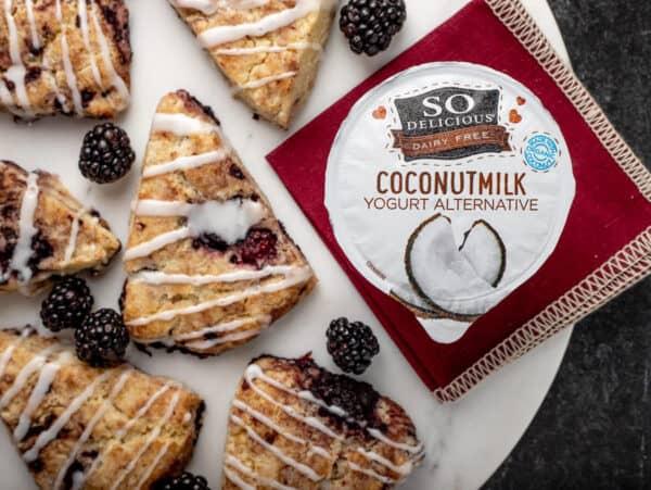 Plate of blackberry scones with So Delicious Yogurt Alternative non dairy