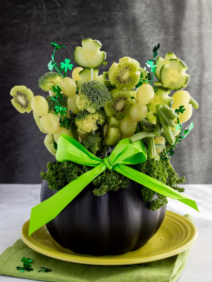 Shamrock edible arrangement with green fruits and vegetables