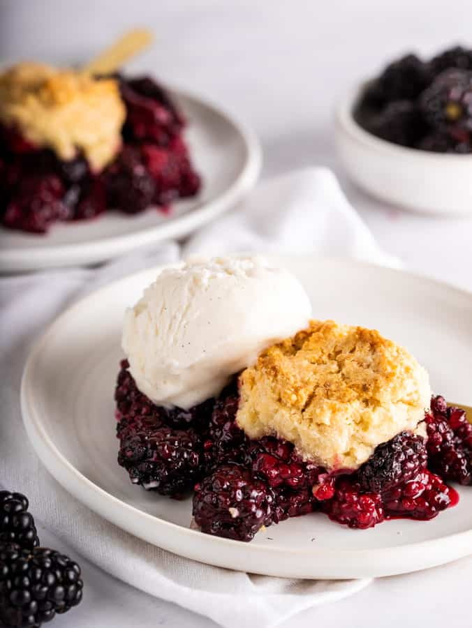 vegan blackberry cobbler on white plate