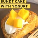 Slice of mango bundt cake with diced mangos