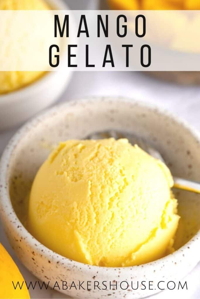 Mango gelato in small bowl with spoon