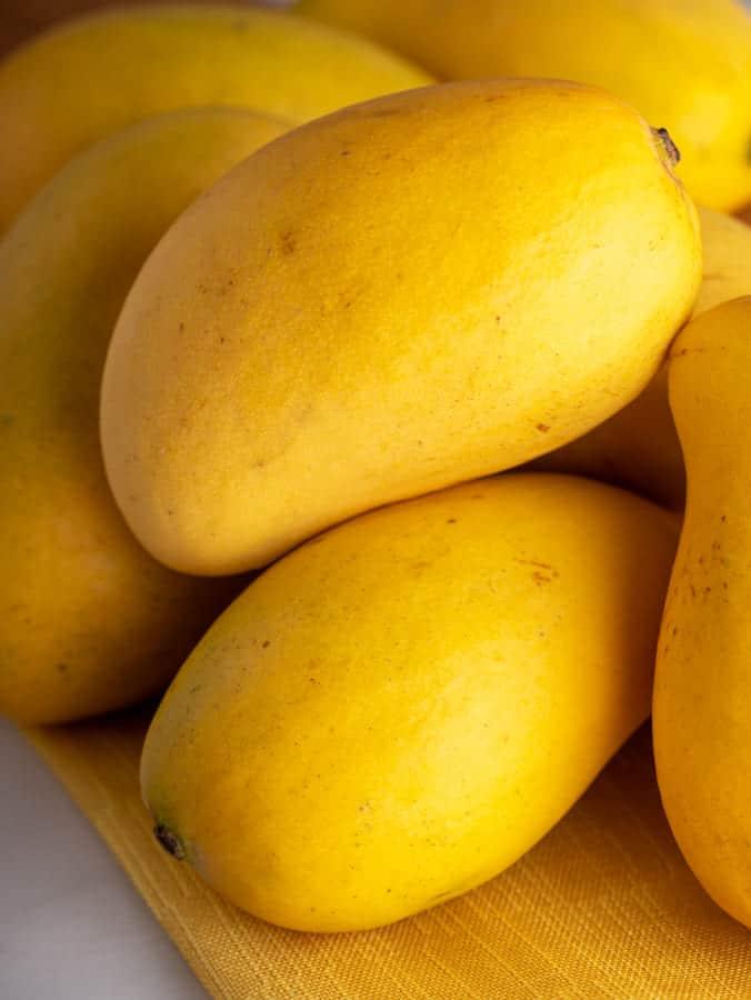 a group of yello mangos