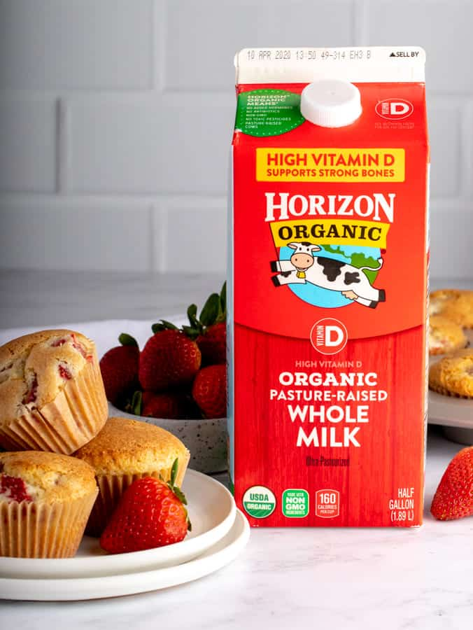 Half Gallon of Horizon Organic Milk on table with plate of muffins and strawberries