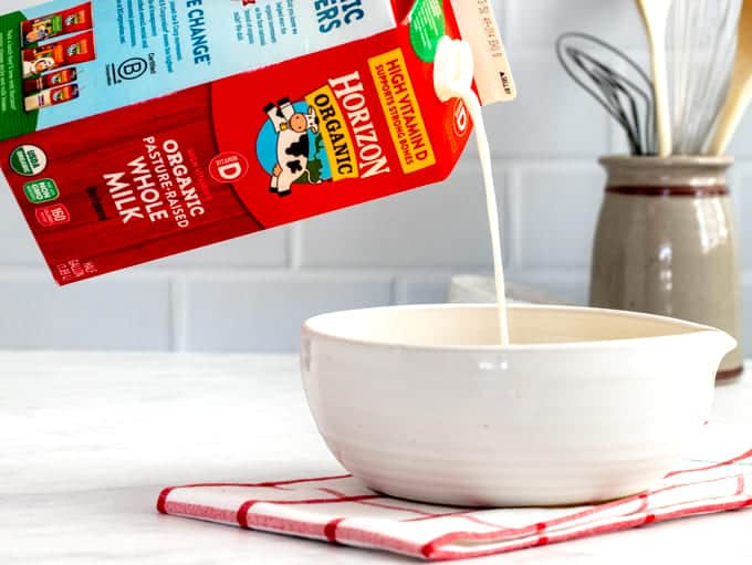 Horizon milk half gallon pouring into a white bowl