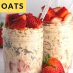 two mason jars filled with overnight oats and topped with strawberries
