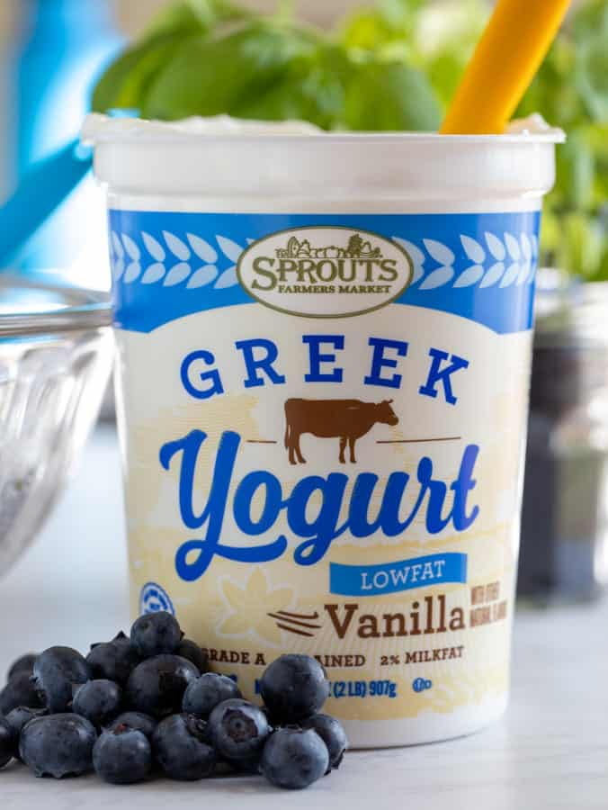 Sprouts Farmers Market container of Vanilla Greek yogurt with fresh blueberries