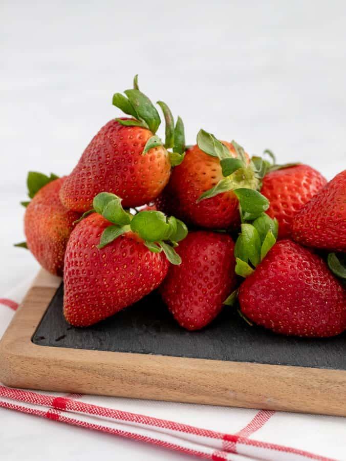 Fresh strawberries on a slate cutting board