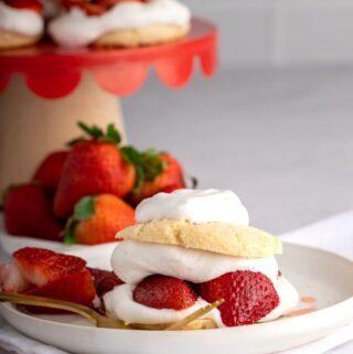 vegan strawberry shortcake on white pottery plate