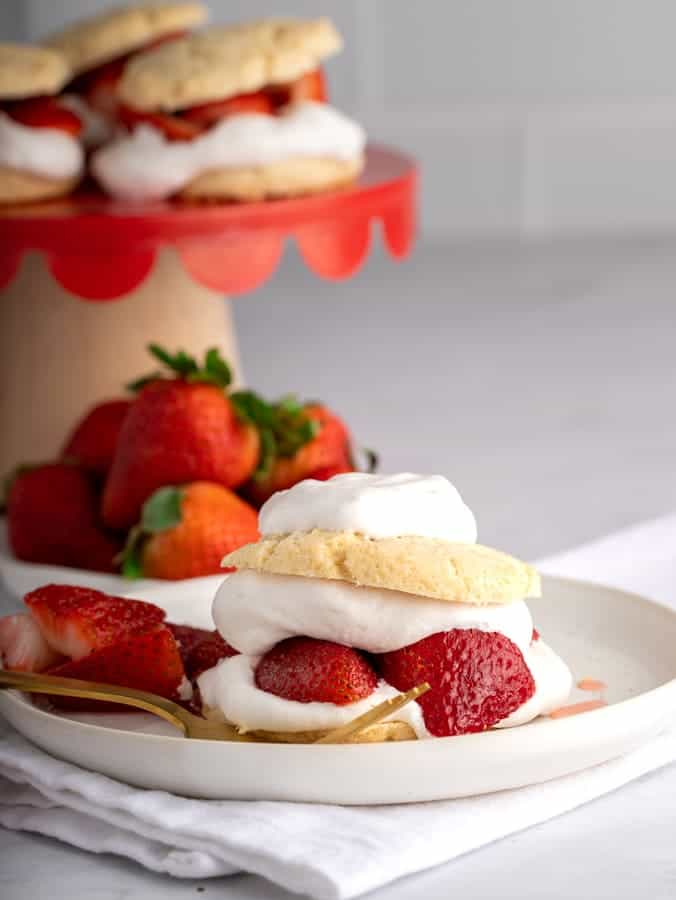 vegan strawberry shortcake on white pottery plate