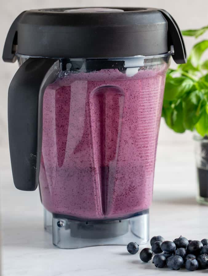 Blueberry and Greek yogurt mixture in a Vitamix blender making popsicles