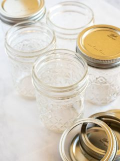 mason jars clean and sterilized on a white surface