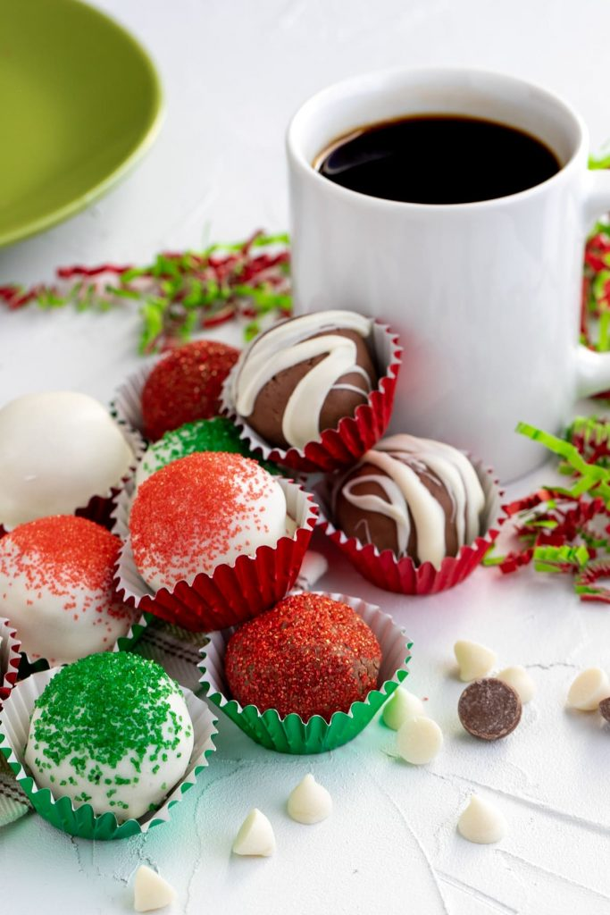 variety of coffee chocolate truffles in baking cups decorated for Christmas in red, green and white