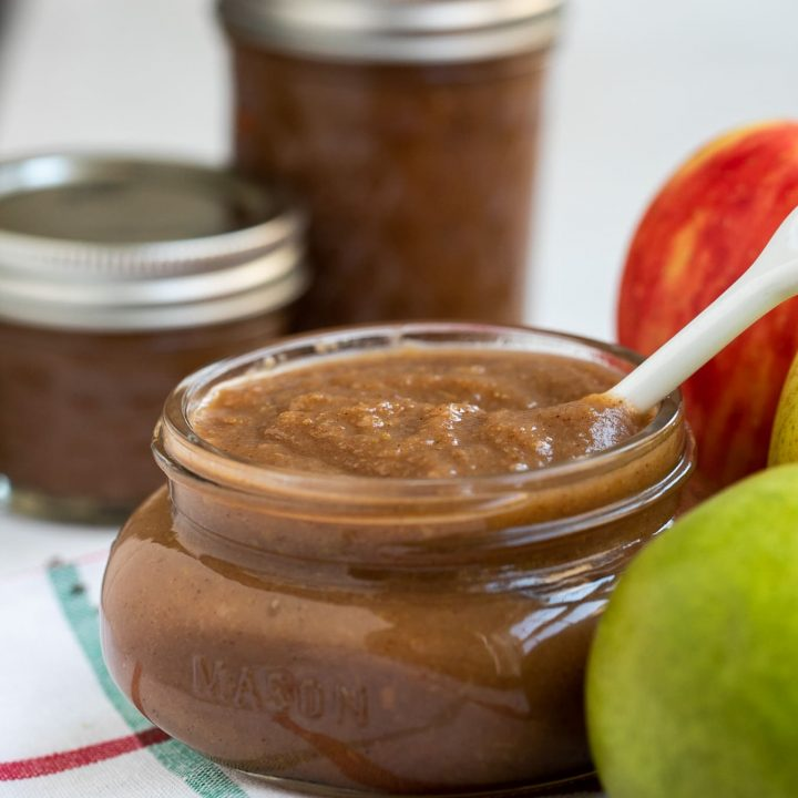 apple pear butter in mason jar next to fruit